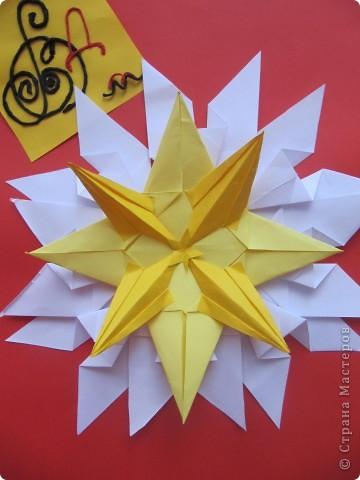"""Мне эта звездочка напоминает снежинку. Я ее сделала из моделей """"крылья, """"ракета"""", """"шатл"""". фото 4"""