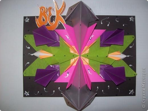 """Тема 1. Это моя необычная звёздочка. Её зовут """"Тайна"""".  Сделал я звёздочку из 2 модулей """"Крылья"""" (зелёные), 2 модулей """"Шаттл"""" (розовые), 2 модулей """"Стрела"""" (серебристые), 4 модулей """"Звездолёт"""" (сиреневые), и 6 модулей """"Ракета"""" (оранжевые). фото 1"""