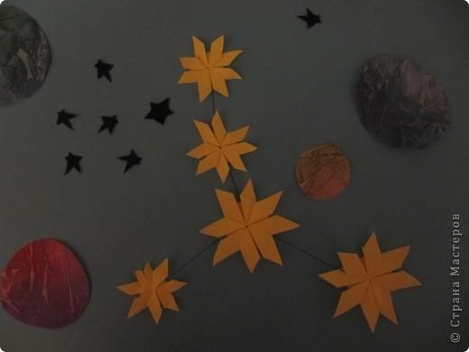 """Мне эта звездочка напоминает снежинку. Я ее сделала из моделей """"крылья, """"ракета"""", """"шатл"""". фото 10"""