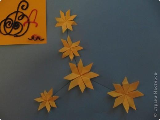 """Мне эта звездочка напоминает снежинку. Я ее сделала из моделей """"крылья, """"ракета"""", """"шатл"""". фото 9"""
