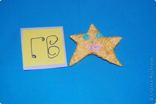эту звезду я сделала из фантиков.4 крыла фото 4