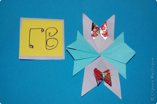эту звезду я сделала из фантиков.4 крыла фото 2