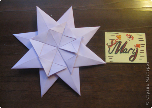 Тема первая. Вот моя звёздочка из модулей. Это звезда мира и света, поэтому я выбрала жёлтый (цвет солнца) и сиреневый (цвет безоблачного неба).  фото 3