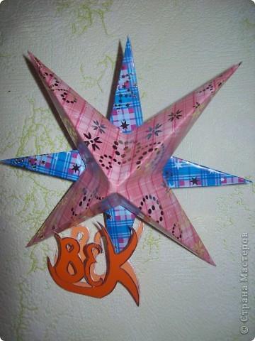 """Тема 1. Это моя необычная звёздочка. Её зовут """"Тайна"""".  Сделал я звёздочку из 2 модулей """"Крылья"""" (зелёные), 2 модулей """"Шаттл"""" (розовые), 2 модулей """"Стрела"""" (серебристые), 4 модулей """"Звездолёт"""" (сиреневые), и 6 модулей """"Ракета"""" (оранжевые). фото 2"""