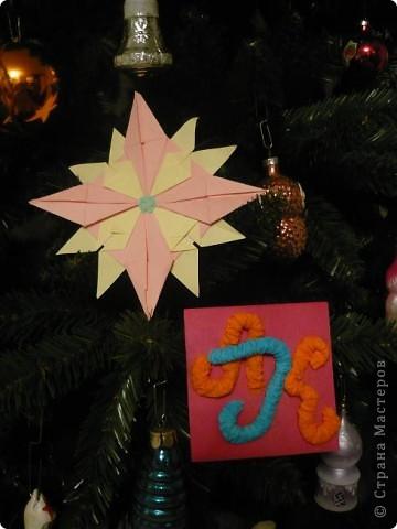 """Мне очень понравилась тема про звезды. Было очень увлекательно складывать модули. Больше всего мне понравились """"Крылья"""" и """"Звездолет"""". Из них я и решила сложить свою звезду. Цвета выбрала свои любимые розовый и желтый. фото 1"""