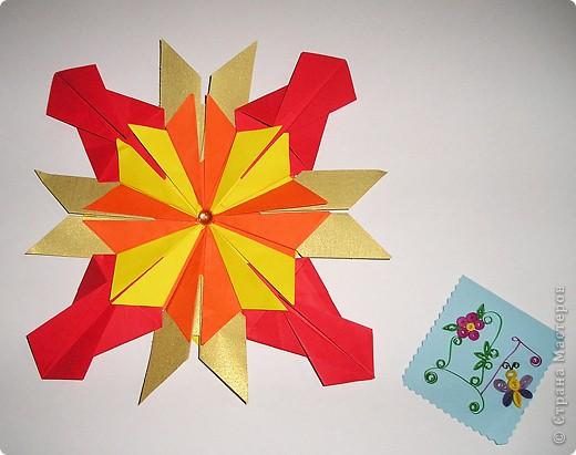 """Тема 1.Моя звезда. Для создания моей звезды я использовала 8 модулей """" Шаттл"""", 4 модуля """"Крылья"""" и 4 модуля """"Комета"""". Моя звезда похожа на цветок. Она называется Незабудка,и каждый,кто ее увидит,не забудет никогда. фото 1"""