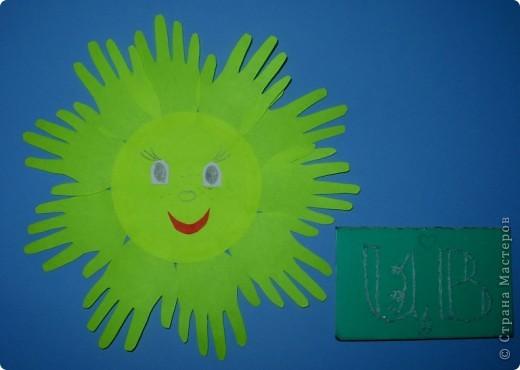 Это мое солнышко из ладошек. Оно мне так нравится! фото 1