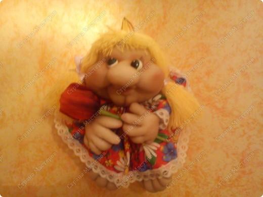 Висит наша куколка на кухне. Если настроение у хозяйки хорошее, то и она улыбается...