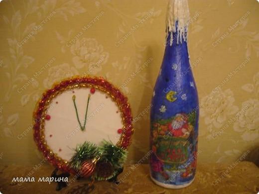 бутылка и часики из конфет фото 1
