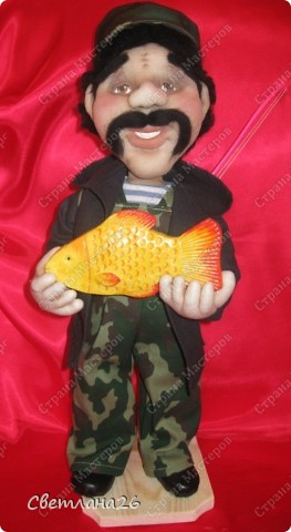 Очередной рыбак. Поймал хороший улов и улыбается во все 32 зуба. фото 1