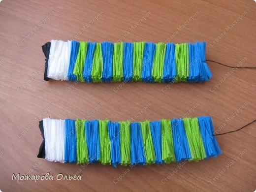 Клоун из гофрированных  спиралек. По такому принципу сделаны ножки и ручки у тигра. http://stranamasterov.ru/node/33597?tid=451%2C1492  фото 9