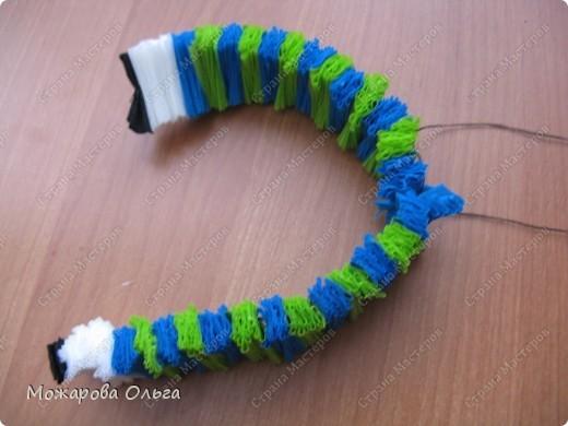 Клоун из гофрированных  спиралек. По такому принципу сделаны ножки и ручки у тигра. http://stranamasterov.ru/node/33597?tid=451%2C1492  фото 10