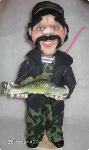 Очередной рыбак. Поймал хороший улов и улыбается во все 32 зуба. фото 5