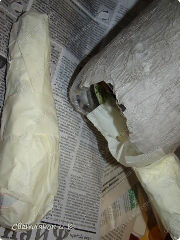 Вот такая зайчиха получилась из бутылки,бумаги и ткани. Придумалась на одном дыхании. фото 6