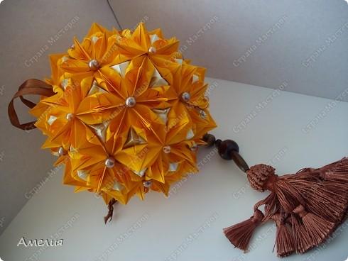 это моя двухсотая кусудама. Модель Stone Flower Всего 90 оранжевых модулей и 60 пирамидок фото 1