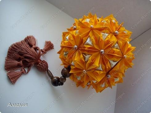 это моя двухсотая кусудама. Модель Stone Flower Всего 90 оранжевых модулей и 60 пирамидок фото 2