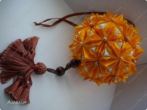 это моя двухсотая кусудама. Модель Stone Flower Всего 90 оранжевых модулей и 60 пирамидок фото 5