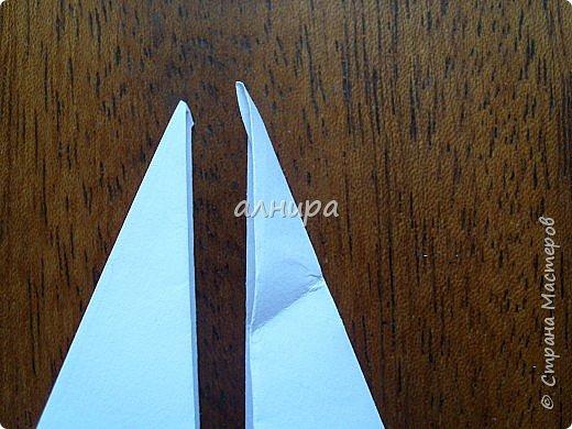 Автор книги-Соколова С.В. Оригами. Большая энциклопедия поделок. Птица складывается просто. А много фотографий, потому что я очень подробно показала. фото 21