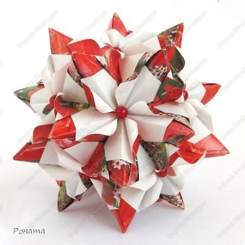 Пока кручу третью капусту (Амелия уговорила :)))), нарядила кое-что новенькое. Как увидела на Фликре эту кусудаму, жутко захотелось разгадать. И вот... Встречайте!  Name: Chandelle en fleur Designer: Maria Sinayskaya Units: 30 Paper: 7.5*7.5 cm Final height: 9.5 cm Бумага корейская, не очень плотная, складки не жесткие, поэтому для надежности подклеила. фото 5