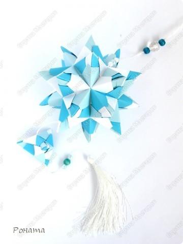 Пока кручу третью капусту (Амелия уговорила :)))), нарядила кое-что новенькое. Как увидела на Фликре эту кусудаму, жутко захотелось разгадать. И вот... Встречайте!  Name: Chandelle en fleur Designer: Maria Sinayskaya Units: 30 Paper: 7.5*7.5 cm Final height: 9.5 cm Бумага корейская, не очень плотная, складки не жесткие, поэтому для надежности подклеила. фото 10