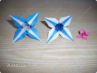 "Еще одни цветочки из книги  Livro de Origami Основа кусудама ""Электра"" автор Девид Митчел http://diagramascia.blogspot.com/search/label/Electra http://www.youtube.com/watch?v=_C0TMbyP_No http://kusuda.ru/kusudamas/kusudama-elektra/ фото 24"