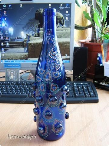 Вот такой необыкновенный павлин поселился у меня на бутыли... фото 1