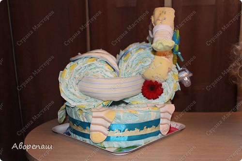 Тема тортов из памперсов не нова. Но все равно , когда  что-то делаешь хочется поделиться и с вами своими трудами.  хочу представить вам небольшой мастер класс тортика из памперсов с мотоциклом. фото 34