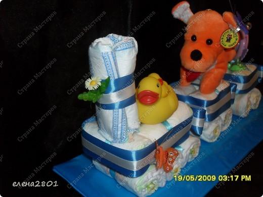 Здравствуйте дорогие мастерицы! На просторах интернета очень много фото с тортами из памперсов,просмотрев которые ,мне тоже захотелось их сделать. Что из этого получилось,судить вам......... Улитка.... фото 7