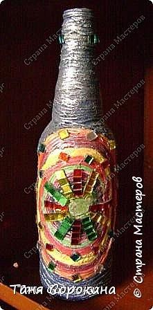 Так, как я придумала технику пейп-арт для своей студии, то и понятно, что эта техника одна из самых любимых у моих учеников. Сегодня я вам покажу работы моих учеников в украшении бутылок. Дети больше любят украшать цветным пейп-артом и добавлять в него ракушки, бусинки и всякие украшения. фото 12