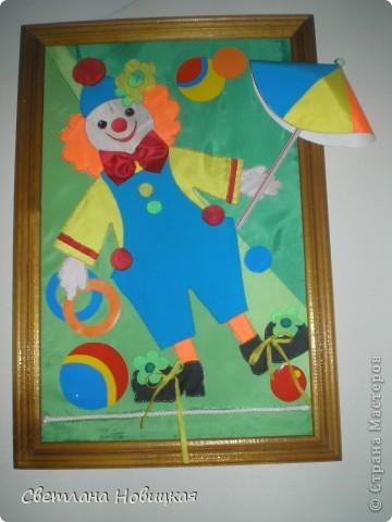 клоун с зонтиком