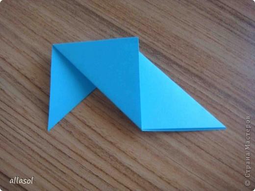 """На кружке с делающими первые шаги в оригами, изучали базовую форму """"треугольник"""". Тренировались на самых простых моделях. Но потом порадовали себя звездочкой. фото 7"""