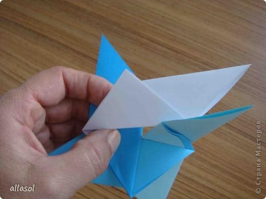 """На кружке с делающими первые шаги в оригами, изучали базовую форму """"треугольник"""". Тренировались на самых простых моделях. Но потом порадовали себя звездочкой. фото 14"""