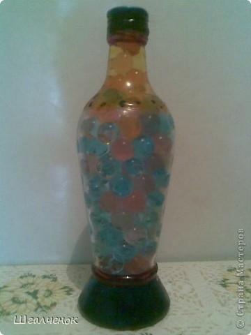 Бутылочка заполненная растущими шариками. фото 2