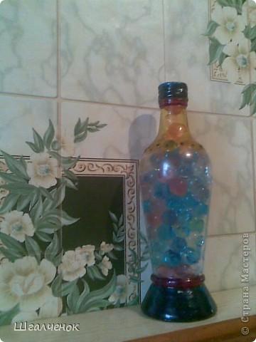Бутылочка заполненная растущими шариками. фото 1