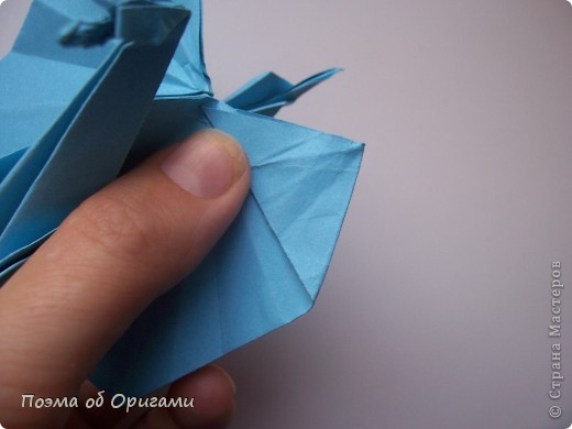 Этого дракона придумал Перри Бейли (США). На востоке драконы, несмотря на весь их грозный вид – это добрые силы, они - связующее звено между миром Земли и божественными Небесами. Кольцо или звезда имеет название «Восемь пятиугольников» и создана Таико Нивой (Япония). В данной интерпретации может быть окном или огненным кольцом, кому уж как больше нравиться:). фото 24