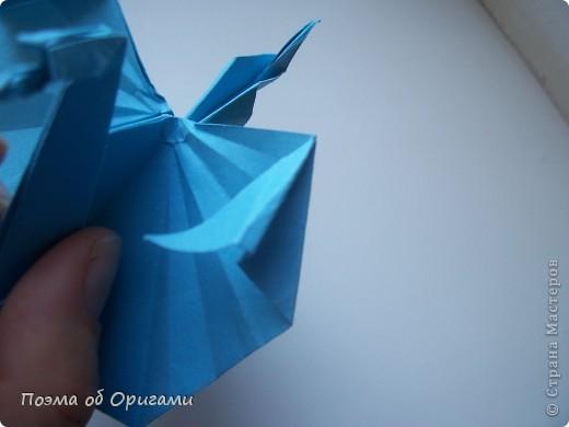 Этого дракона придумал Перри Бейли (США). На востоке драконы, несмотря на весь их грозный вид – это добрые силы, они - связующее звено между миром Земли и божественными Небесами. Кольцо или звезда имеет название «Восемь пятиугольников» и создана Таико Нивой (Япония). В данной интерпретации может быть окном или огненным кольцом, кому уж как больше нравиться:). фото 25