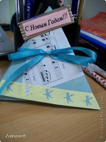 вот такая вот повторюша, идея - es-denol: http://stranamasterov.ru/node/123321?tid=311 правда я сделала открытку из двух треугольников, склеенных вместе фото 1