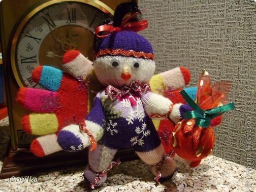 Скорее всего-Рождественский ангел.У него и подарок есть! фото 1