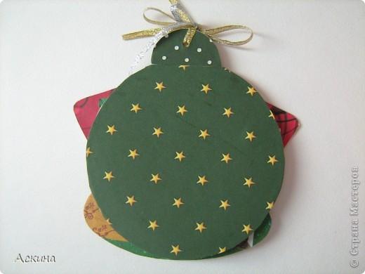 Альбомчик делала по этому МК http://scrap-info.ru/myarticles/article_storyid_288.html, правда у меня не было готовых фигур звезды,елки и шара,пришлось самой нарисовать и вырезать из твердого картона. фото 9