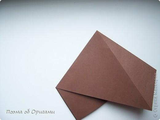 Эта башня составлена из одинаковых блоков и может быть логически продолжена до бесконечности: включать сколько угодно подобных секций и уровней. Поэтому эта модель отлично подходит для коллективной работы в коллективе. Модель этой симпатичной девушки носит имя НОА-чан и со времени со своего рождения даже успела стать символом Японской Ассоциации Оригами. фото 24