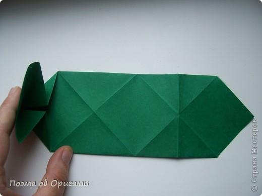 Эта башня составлена из одинаковых блоков и может быть логически продолжена до бесконечности: включать сколько угодно подобных секций и уровней. Поэтому эта модель отлично подходит для коллективной работы в коллективе. Модель этой симпатичной девушки носит имя НОА-чан и со времени со своего рождения даже успела стать символом Японской Ассоциации Оригами. фото 9