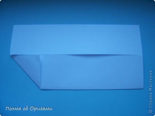 В качестве символа 2011 год делят между собой два животного китайского календаря. Видимо, это не простое совпадение, ведь у них и правда много общего. Оба с кротким нравом и пушистой шубкой.  Этого кролика придумал Стефан О`Хонор, а котика – Джо Накашима.  Подставка в форме четырех сердец – модель Френсиса Оу. Вся композиция сложена из квадратов одинакового размера(2 красных и 2 белых), в данном случае 20х20см. Как сложить из полос бумаги цифры – можете вспомнить в этом МК: http://stranamasterov.ru/node/127038 фото 21