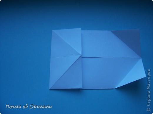 В качестве символа 2011 год делят между собой два животного китайского календаря. Видимо, это не простое совпадение, ведь у них и правда много общего. Оба с кротким нравом и пушистой шубкой.  Этого кролика придумал Стефан О`Хонор, а котика – Джо Накашима.  Подставка в форме четырех сердец – модель Френсиса Оу. Вся композиция сложена из квадратов одинакового размера(2 красных и 2 белых), в данном случае 20х20см. Как сложить из полос бумаги цифры – можете вспомнить в этом МК: https://stranamasterov.ru/node/127038 фото 23