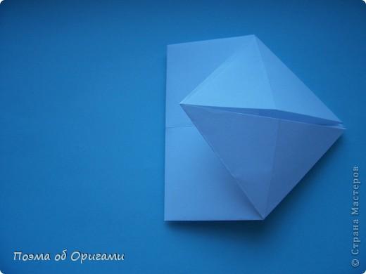 В качестве символа 2011 год делят между собой два животного китайского календаря. Видимо, это не простое совпадение, ведь у них и правда много общего. Оба с кротким нравом и пушистой шубкой.  Этого кролика придумал Стефан О`Хонор, а котика – Джо Накашима.  Подставка в форме четырех сердец – модель Френсиса Оу. Вся композиция сложена из квадратов одинакового размера(2 красных и 2 белых), в данном случае 20х20см. Как сложить из полос бумаги цифры – можете вспомнить в этом МК: https://stranamasterov.ru/node/127038 фото 31