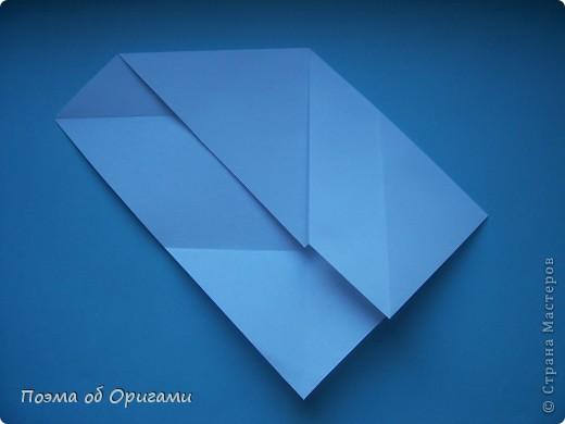 В качестве символа 2011 год делят между собой два животного китайского календаря. Видимо, это не простое совпадение, ведь у них и правда много общего. Оба с кротким нравом и пушистой шубкой.  Этого кролика придумал Стефан О`Хонор, а котика – Джо Накашима.  Подставка в форме четырех сердец – модель Френсиса Оу. Вся композиция сложена из квадратов одинакового размера(2 красных и 2 белых), в данном случае 20х20см. Как сложить из полос бумаги цифры – можете вспомнить в этом МК: http://stranamasterov.ru/node/127038 фото 48