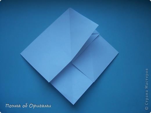 В качестве символа 2011 год делят между собой два животного китайского календаря. Видимо, это не простое совпадение, ведь у них и правда много общего. Оба с кротким нравом и пушистой шубкой.  Этого кролика придумал Стефан О`Хонор, а котика – Джо Накашима.  Подставка в форме четырех сердец – модель Френсиса Оу. Вся композиция сложена из квадратов одинакового размера(2 красных и 2 белых), в данном случае 20х20см. Как сложить из полос бумаги цифры – можете вспомнить в этом МК: http://stranamasterov.ru/node/127038 фото 54