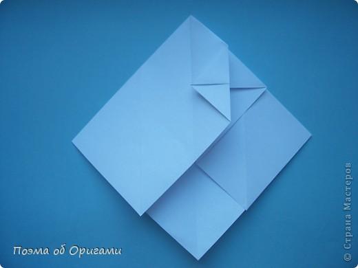 В качестве символа 2011 год делят между собой два животного китайского календаря. Видимо, это не простое совпадение, ведь у них и правда много общего. Оба с кротким нравом и пушистой шубкой.  Этого кролика придумал Стефан О`Хонор, а котика – Джо Накашима.  Подставка в форме четырех сердец – модель Френсиса Оу. Вся композиция сложена из квадратов одинакового размера(2 красных и 2 белых), в данном случае 20х20см. Как сложить из полос бумаги цифры – можете вспомнить в этом МК: https://stranamasterov.ru/node/127038 фото 55