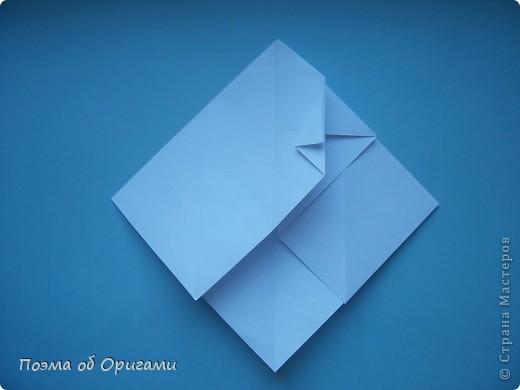 В качестве символа 2011 год делят между собой два животного китайского календаря. Видимо, это не простое совпадение, ведь у них и правда много общего. Оба с кротким нравом и пушистой шубкой.  Этого кролика придумал Стефан О`Хонор, а котика – Джо Накашима.  Подставка в форме четырех сердец – модель Френсиса Оу. Вся композиция сложена из квадратов одинакового размера(2 красных и 2 белых), в данном случае 20х20см. Как сложить из полос бумаги цифры – можете вспомнить в этом МК: https://stranamasterov.ru/node/127038 фото 56