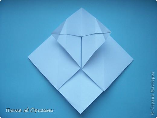 В качестве символа 2011 год делят между собой два животного китайского календаря. Видимо, это не простое совпадение, ведь у них и правда много общего. Оба с кротким нравом и пушистой шубкой.  Этого кролика придумал Стефан О`Хонор, а котика – Джо Накашима.  Подставка в форме четырех сердец – модель Френсиса Оу. Вся композиция сложена из квадратов одинакового размера(2 красных и 2 белых), в данном случае 20х20см. Как сложить из полос бумаги цифры – можете вспомнить в этом МК: https://stranamasterov.ru/node/127038 фото 57