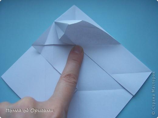 В качестве символа 2011 год делят между собой два животного китайского календаря. Видимо, это не простое совпадение, ведь у них и правда много общего. Оба с кротким нравом и пушистой шубкой.  Этого кролика придумал Стефан О`Хонор, а котика – Джо Накашима.  Подставка в форме четырех сердец – модель Френсиса Оу. Вся композиция сложена из квадратов одинакового размера(2 красных и 2 белых), в данном случае 20х20см. Как сложить из полос бумаги цифры – можете вспомнить в этом МК: http://stranamasterov.ru/node/127038 фото 58